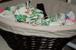 A smaller basket on the shelf organizes swimwear