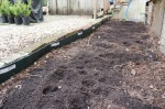 Garden edging holds in the soil and keeps my bricks in place