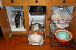 Base cabinets with fresh paint and organization system