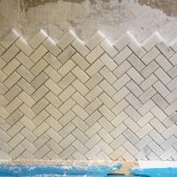 Herringbone marble backsplash tile