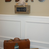 Block letters, wainscoting and vintage luggage