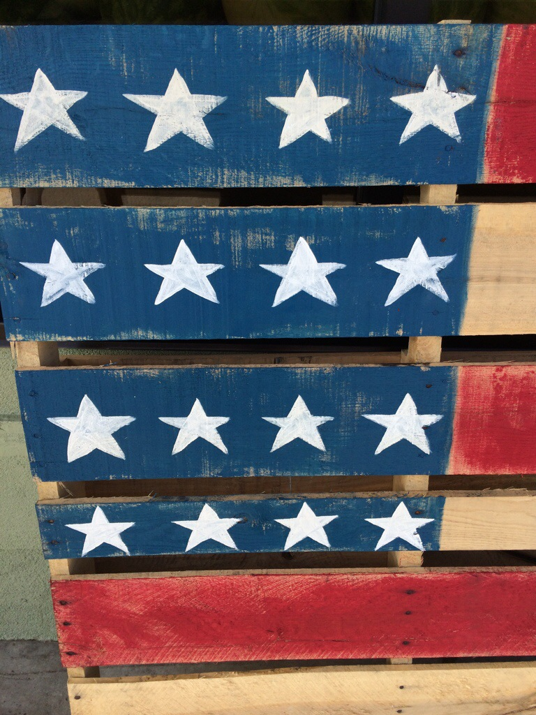 Wood pallet flag at Whole Foods