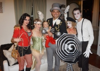 Lion tamer, trapeze artist, strongman, ringmaster and mimes
