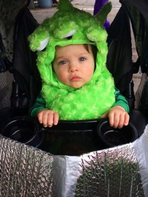 Baby Beau in his Mardi Gras martian UFO stroller