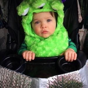 Baby Beau in his Mardi Gras martian UFO stroller